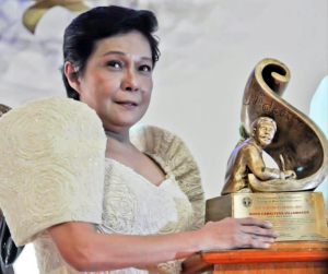 Nora with her Gawad Plaridel trophy from the University of the Philippines.